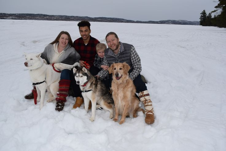 Katrina St. Clair with my husband Siah, sons Michael and SJ and me.  Dogs in the photo are Kyra, Marley and Adopt A Husky foster Kolo - This is a family photo we took just last month on a trip up north for our wedding anniversary - on Gunflint Lake at the Gunflint Lodge #mukluk #stegermukluks