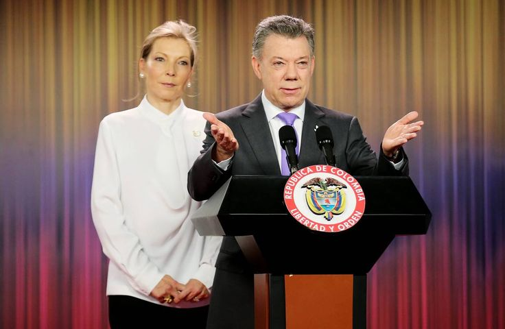 Colombian President Juan Manuel Santos, right, spoke at a press conference with his wife María...
