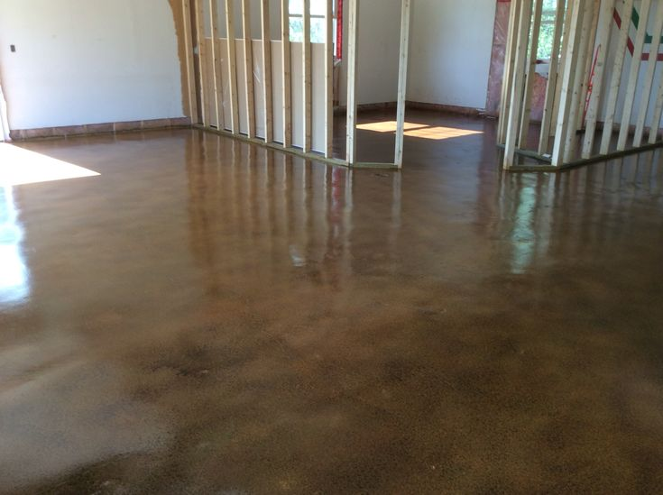 We stained the existing garage floor concrete with three tones of semi-transparent concrete stain. Love the distressed leathery result!