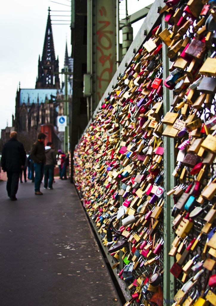 Leaving an engraved lock on the Hohenzollernbrücke, the bridge of love, in Cologne.