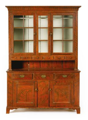 A VERY FINE FEDERAL RED AND BLACK PAINT-DECORATED POPLAR STEP-BACK CUPBOARD, Pennsylvania, Circa 1800 Estimate $40,000 - $80,000 USD With glazed doors. The upper section lacking three plate rails.                Height 86 in. by Width 61 1/2  in. by Depth 19 1/2  in   Provenance Effie Thixton Arthur (1902–1979), Wilton, Connecticut;  Public Institution;  Sotheby's New York, Important Americana, June 18, 1997, Sale 7010, lot 682.