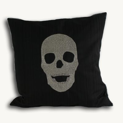 A funky silver skull design on a black cushion will make a fashionable addition to your sofa or bed.