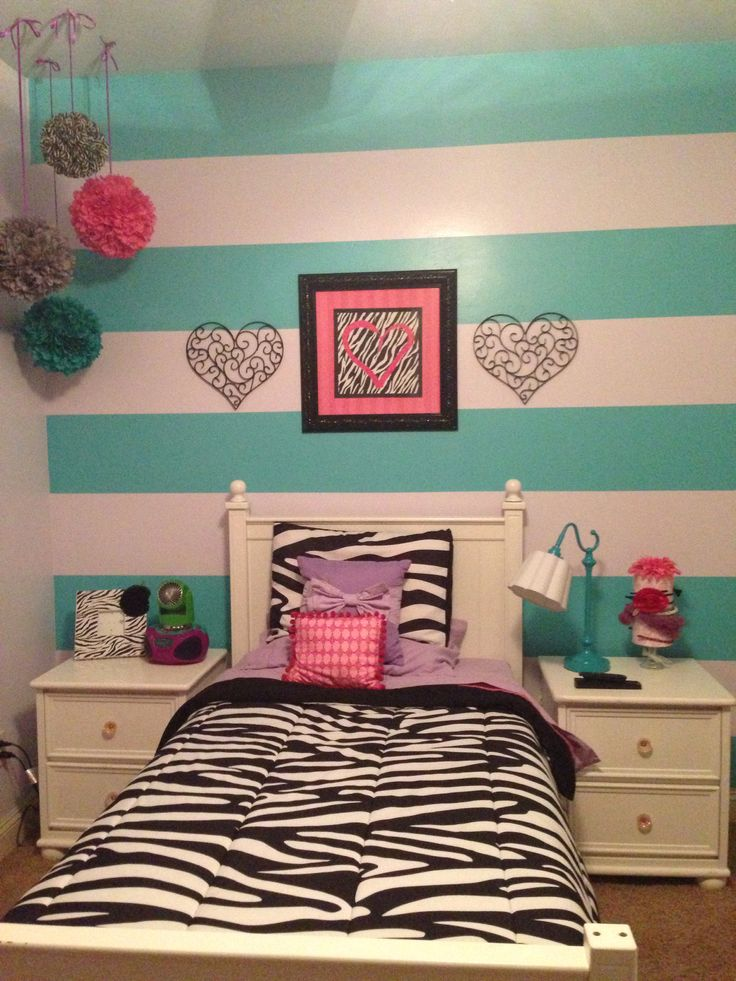 Zebra print purple pink teal gray big girl tween bedroom with stripes behind bed