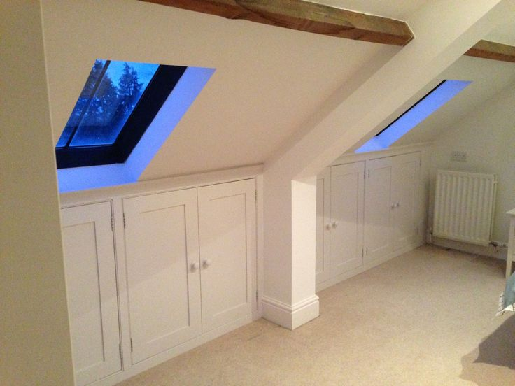 Many use of every scrap of space under the eaves in this bedroom!  Tailor made by Dunham Fitted Furniture