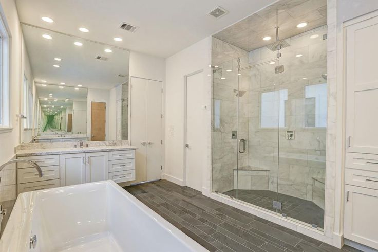 1201 Drew Houston, TX 77006: Photo Large Walk-In Shower with Seamless Shower Door, Wall Mounted and Ceiling Mounted Shower Heads, Built-In Seat and Tile Surround plus a Kohler Free-Standing Bath. There is also a Separate Commode Area plus tons of storage for towels and linens.