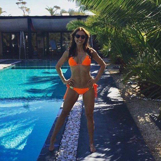 A dream in tangerine: Melanie Sykes showed off her svelte figure in a neon