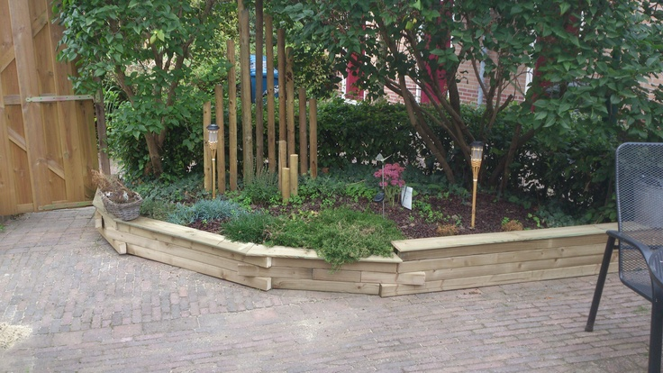 Renovatie van verhoogde borders met hout
