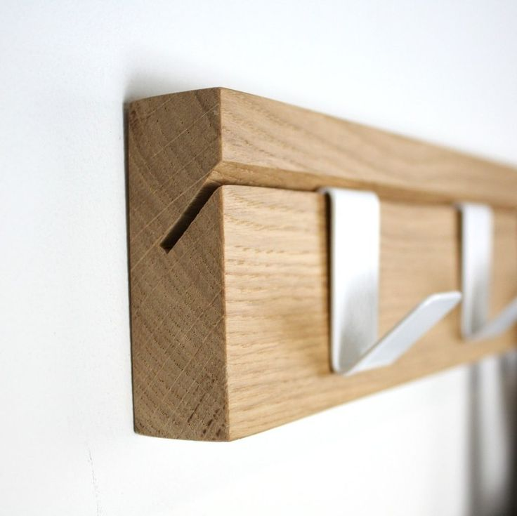 A solid oak coat rail supplied with 5 cantilevered steel hooks. Each hook can be moved independently, locating into the 45 degree slots from which the product takes its name. Proudly made in the UK...
