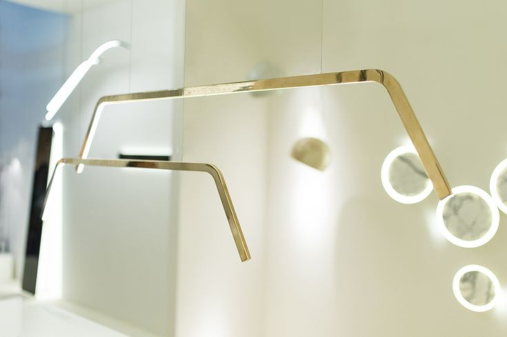 D'ARC  Double-bent polished bronze profile with high performance LED lights www.inarchi.com #darc #suspended #inarchi #inarchilamps #minimal #design #designer #light #lighting #lamps #bronze #bent #double #polished #beautiful #elegant #exclusive #composition