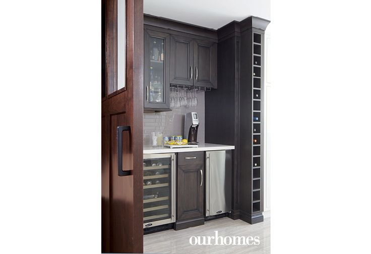 The home bar sits near the home office. - Via OUR HOMES Hamilton Spring 2016.  http://www.ourhomes.ca/articles/build/article/removing-walls-in-ushaped-kitchen-for-entertaining