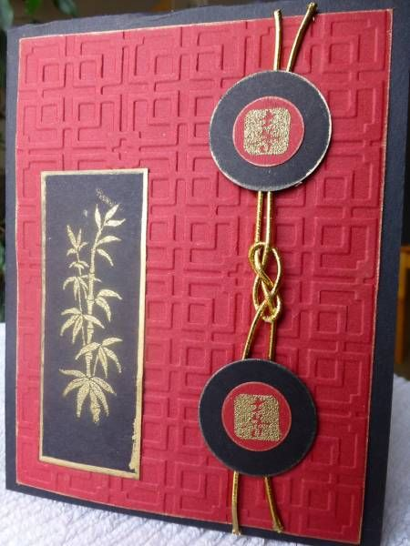 handmade card ... Asian theme ... black, red, gold ... knotted gold cord ... embossing folder texture like a wooden screen texture ... gold embossed bamboo and script ... gold gilt edges on black pieces ... lovely card! ...