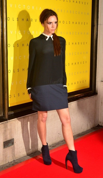 Victoria Beckham at the launching event of her fashion line 'Victoria' at Harvey Nichols. 17 Feb 2102, London. Victoria dress, Walter Steiger boots