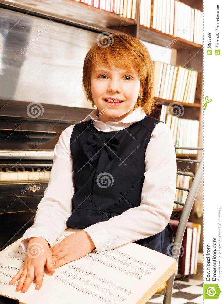 Happy Girl In School Uniform Holding Piano Notes Stock Photo - Image of lesson, keyboard: 53973258