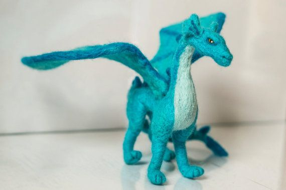 Felted handmade dragon. Made from natural wool, have strong wire armature inside. About 11 cm tall and 26cm long. One wing have 12cm.