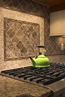 Beautiful backsplash!  Back-splashes are such hidden gems in the kitchen.