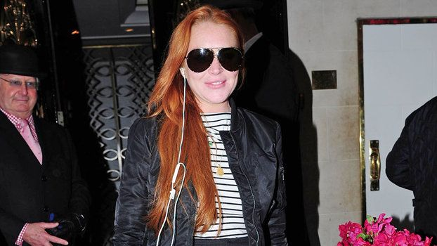 Lindsay Lohan Gives Off Serious Mean Girl Vibes with Her Jacket http://dev.trib.al/rD9Y7tb