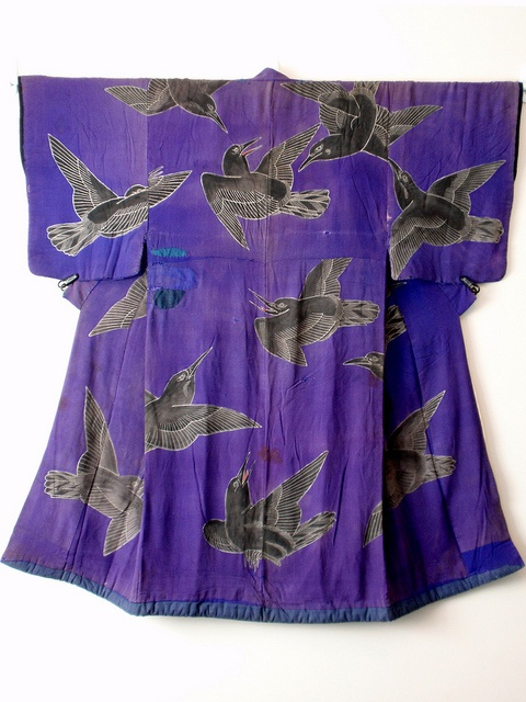 This is a late Edo period (1860s) Kabuki costume made of Chirimen (silk crepe) and depicting Crows fighting amongst themselves in mid flight, using the Rozome (wax resist dyeing) technique.
