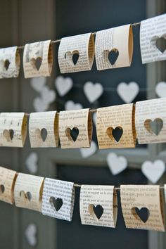 Punch heart shapes through old book pages to create this pretty bunting!   Image:Etsy