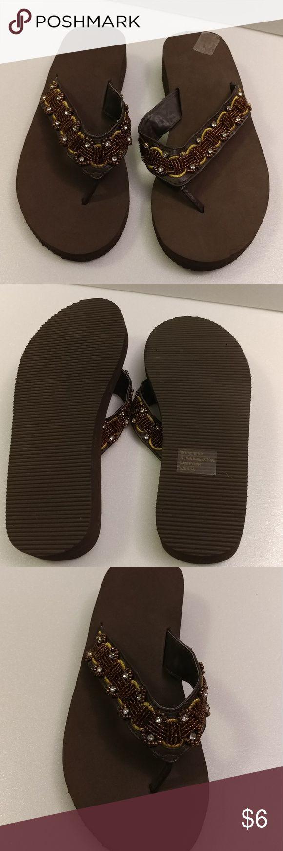 Brown Flip Flops 🆕 Brown flip flops. In good condition. Shoes Sandals