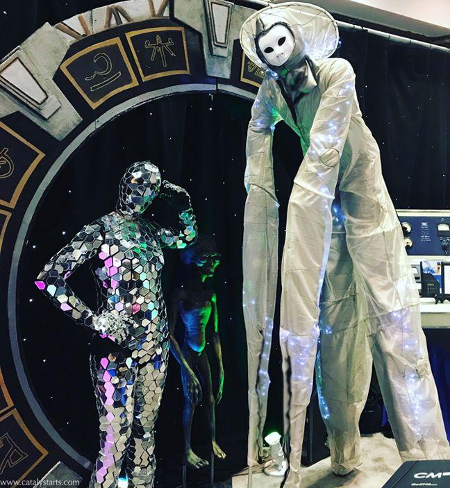Mirror suit dancer + alien stilt walker futuristic entertainment by Catalyst Arts