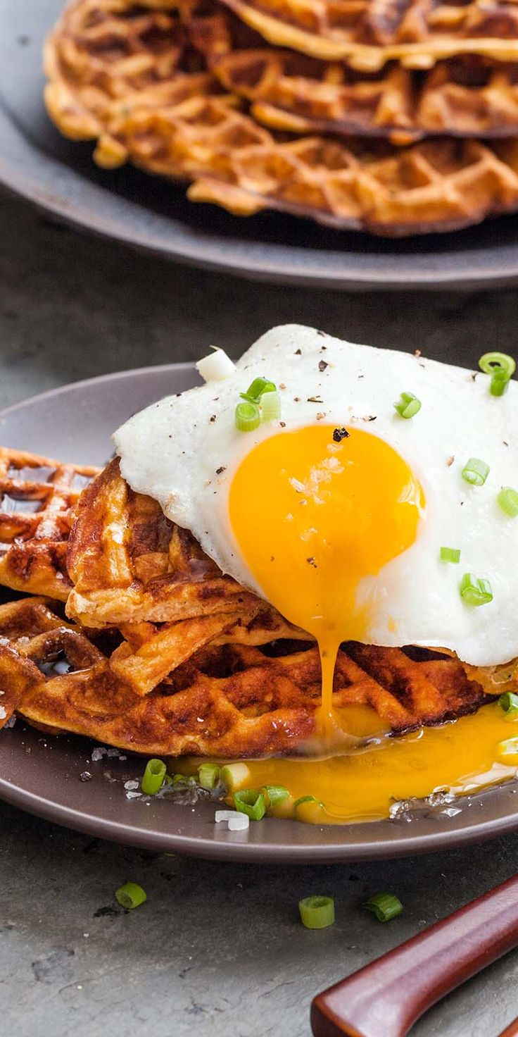 Make these sweet potato waffles with fried egg, bacon, and scallions for breakfast, lunch, or dinner! Great way to use up leftover sweet potatoes. #waffles #SweetPotatoes #brunch #breakfast