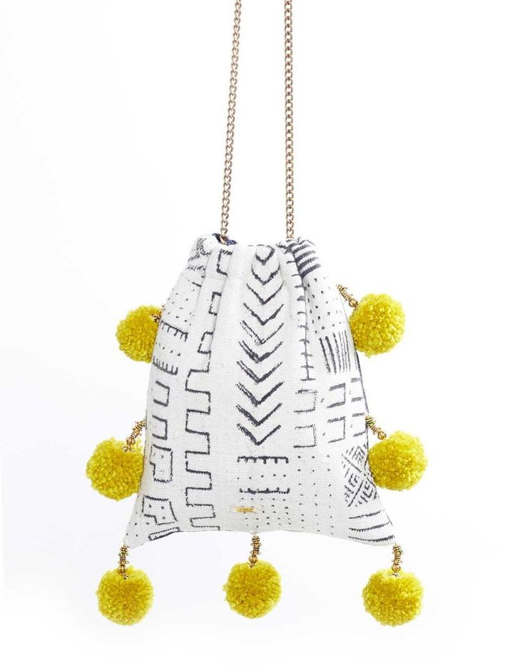 """- Description - Artisan We love this vibrant pom pom bag, perfect for the beach, brunch, and everything in between! * Approximately 9"""" long x 8"""" wide; 20"""" chain; 1.5"""" pom poms * As with all handwoven"""