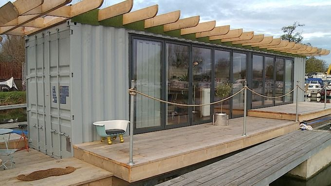 A floating home created from a metal shipping container. #containerhome #shippingcontainer