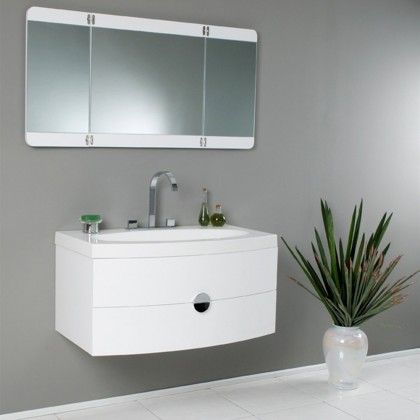 the energia vanity from fresca features curved lines and a white finish for a fresh modern bathroom