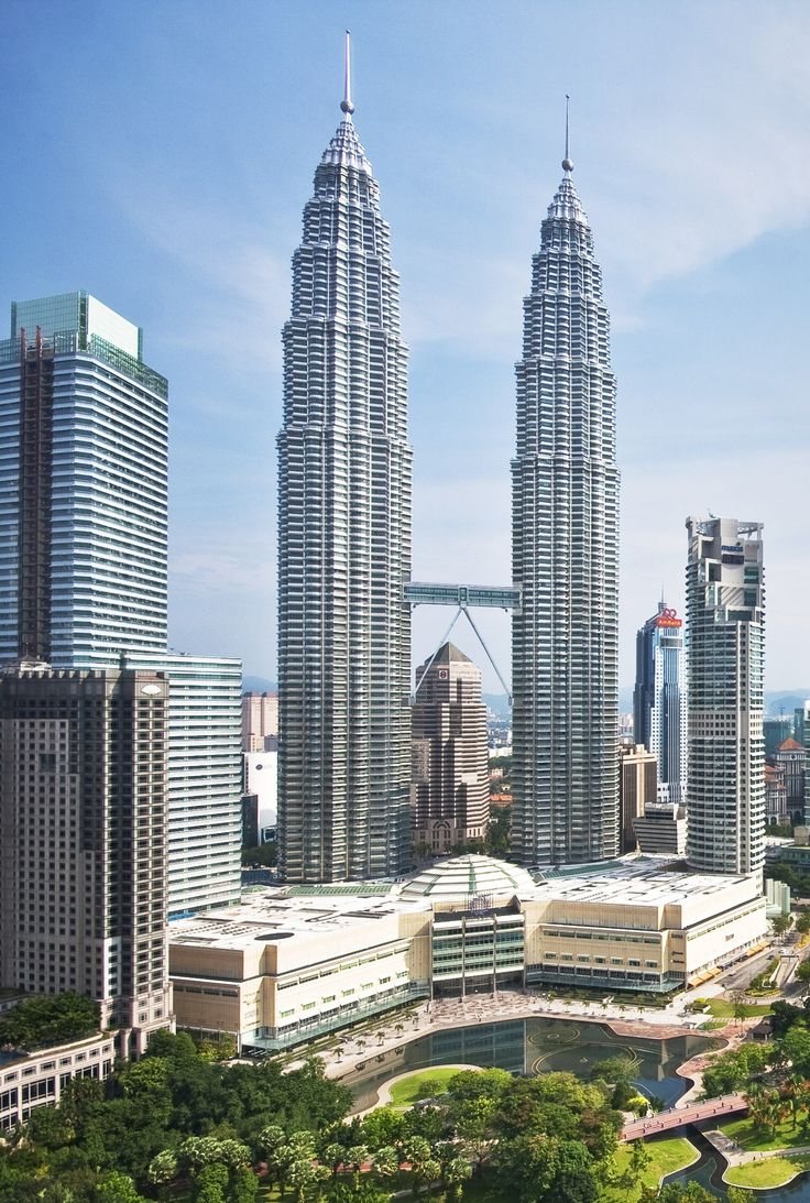 Completed in 1997, the Petronas Towers in Kuala Lumpur, Malaysia, held the title of world's tallest buildings until 2004. The architecture takes its inspiration from Malaysian crafts and materials and Islamic design motifs. The twin 88-story towers are connected by a two-story sky bridge at the 41st and 42nd floors.