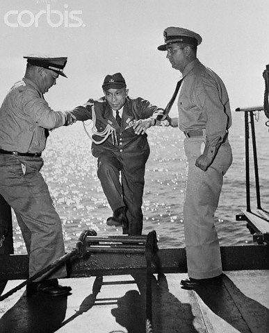 Japanese Officer Assisted by US Officers - U771955ACME - Rights Managed - Stock Photo - Corbis. Rear Admiral Densuke Kanome, Chief of Staff of the Ominate Naval Base, is assisted aboard the USS Panamint by Chief Bos'n W. Moffitt (left) and Lieutenant H.A. Hoover. Kanome and other emissaries came to Vice Admiral F.J. Fletcher's flagship to receive surrender instructions. September 16, 1945.