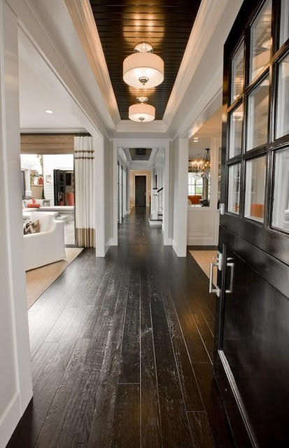 Love the dark wood, white crown molding, and ceiling details