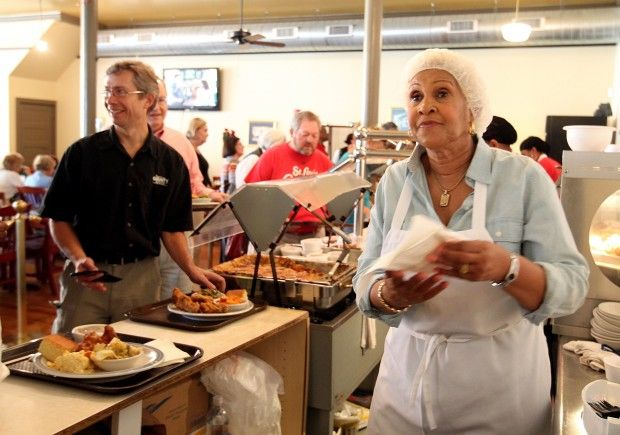 Robbie Montgomery (right), owner of Sweetie Pie's, works the cafeteria line at the soul food restaurant in the Grove. (Christian Gooden/cgooden@post-dispatch.com)