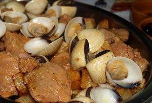 Ingredients: 1/2 pound littleneck clams 1/2 pound pork fillet, cubed 1 teaspoon paprika Salt and Pepper to taste 2 cloves garlic, peele...