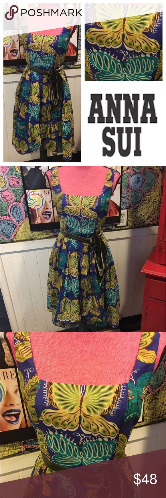 """Funky ANNA SUI s4 butterfly 🦋 DRESS 😍 How fun is this Anna Sui dress.  Size 4 super interesting colors are all over the place.  Chest is 30"""" waist is 24"""".  I love the velvet green belt.   There are three layers...for puffy bottom.  In like new condition except inside purple has worn down a little.   Can't tell unless your looking inside.  Otherwise the dress is perfect funk. Anna Sui Dresses"""