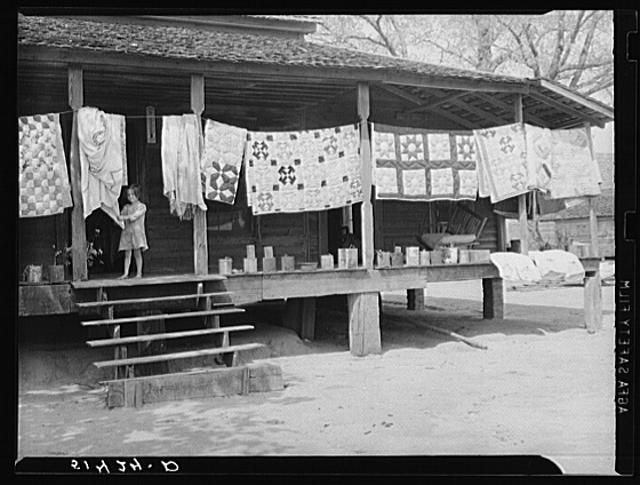 Typical farmhouse, spring housecleaning, homemade quilts and bedding in sun. Coffee County, Alabama