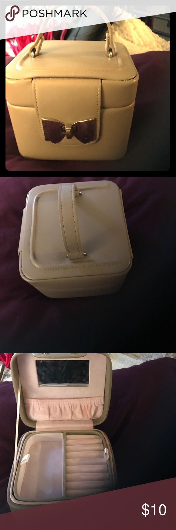 Cream vintage jewelry/makeup bow case Has been used. See photos. Inside has makeup stains but can be cleaned. Outside and top drawer with mirror in good condition. Tuscan Designs Bags Cosmetic Bags & Cases