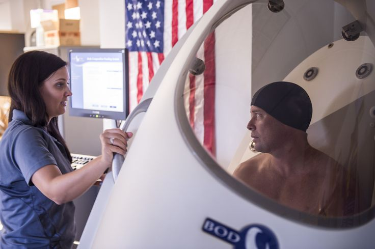 Meleesa Wohleber, a University of Pittsburgh assistant professor, measures Senior Master Sgt. Kenneth Huhman's body composition. The measurements are a small part of the overall evaluation. (U.S. Air Force photo/Master Sgt. Jeffrey Allen)