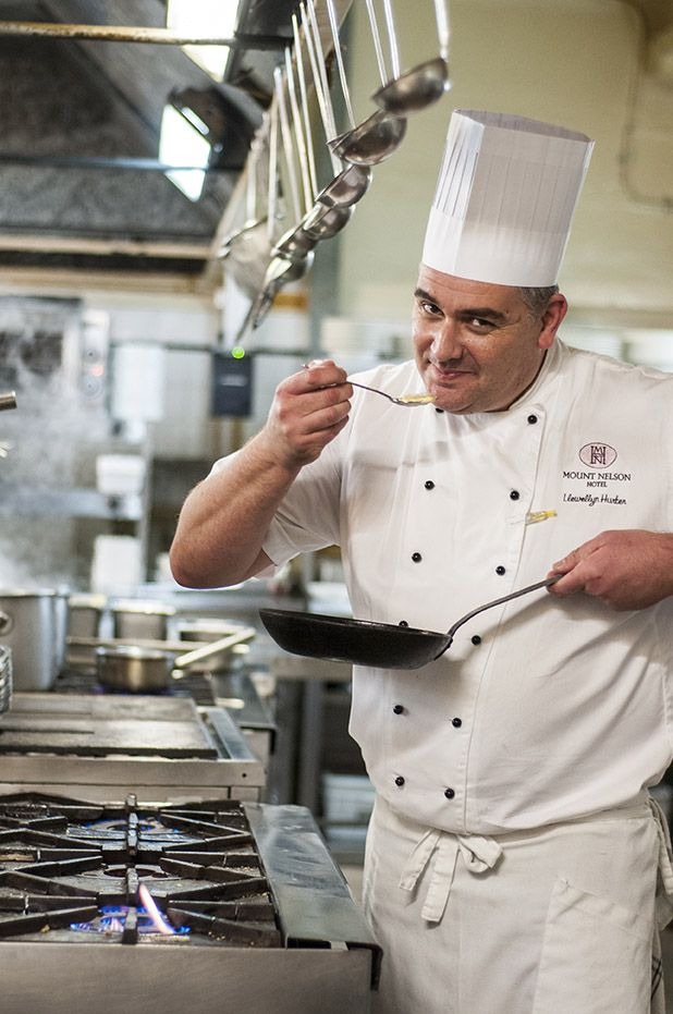 Chef Llewellyn Hurter in The Mount Nelson Kitchen in his Minted Ginger Classic Jacket - created and embroidered by Minted Ginger