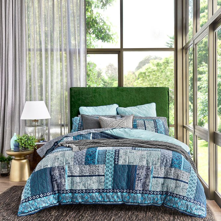 Create a natural, organic look that doesn't limit you to neutral tones by introducing ocean blues and greenery #bedroomdecor #homestyle #bedbathntable