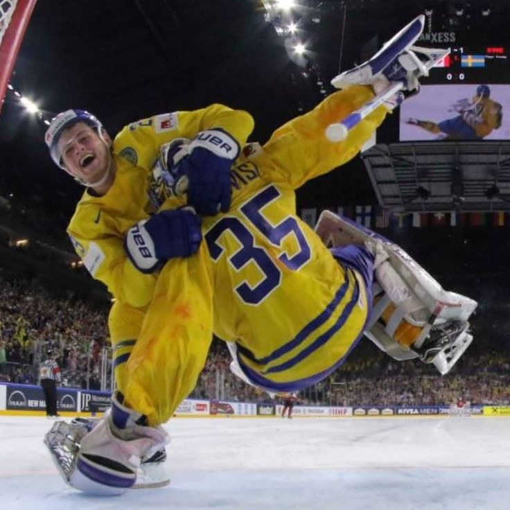 """""""I'm telling your dad!"""" William Nylander jumps on Henrik Lundqvist as Sweden win Gold. Lundqvist was teammates on #NYR with William's dad Michael Nylander."""