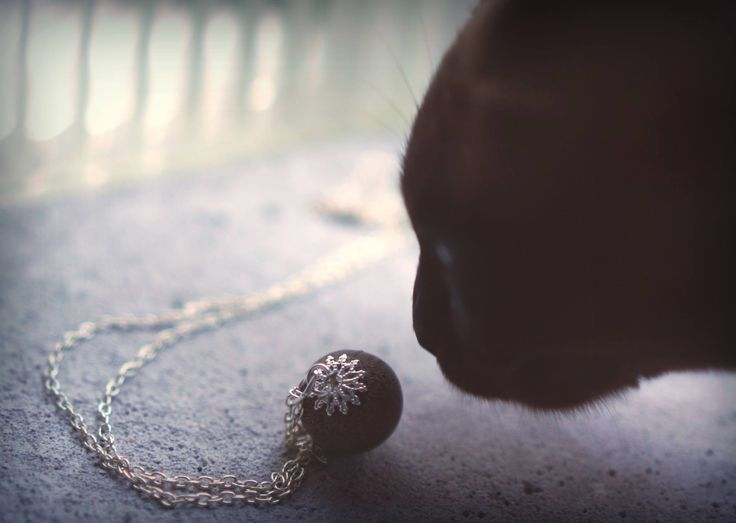 Concrete ball with silver chain.