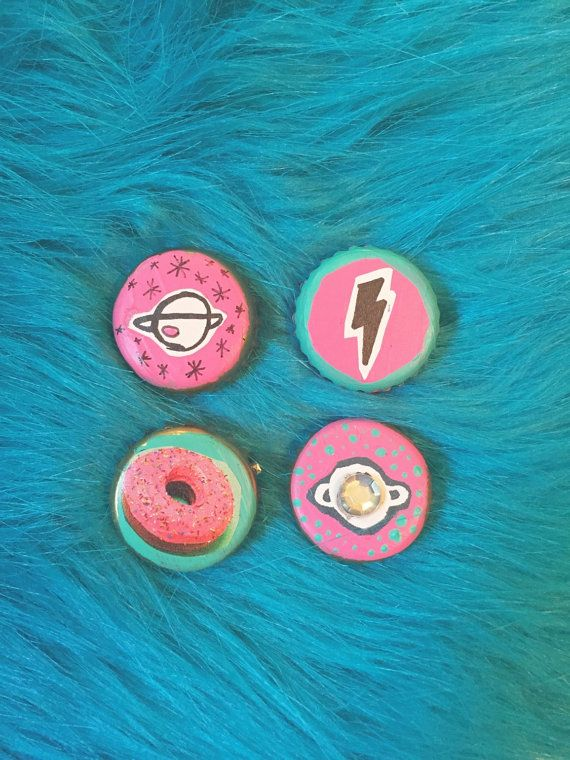 Cosmic recycled bottle cap button pins hand painted with collage aspects by Studio Omega