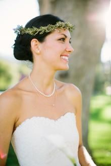 The Heritage Cotton lace of Lavender, an Amy Kuschel wedding gown, pairs beautifully with Katie's crown of baby's breath.   Photography by Carmen Holt.