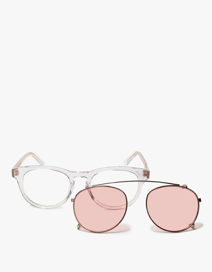 In an exclusive collaboration between Need Supply Co. and Han Kjobenhavn, the Timeless. Clear acetate frames with removable clip-on Pink clip-on sunglasses. Aviator-style top bar. Notched bridge. Seamless nosepads. Narrow arms with visible gold hardware.