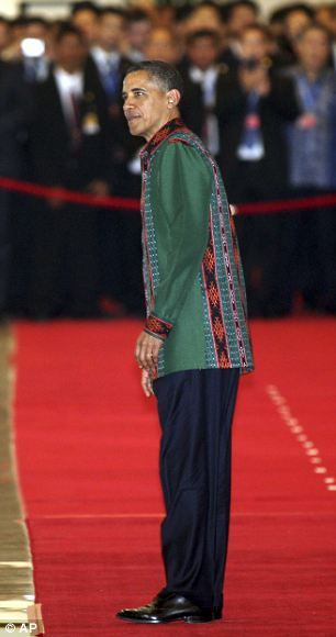 U.S. President Barack Obama walks on the red carpet upon arrival for a gala dinner at ASEAN Summit in Nusa Dua, Bali, Indonesia, Friday, Nov...