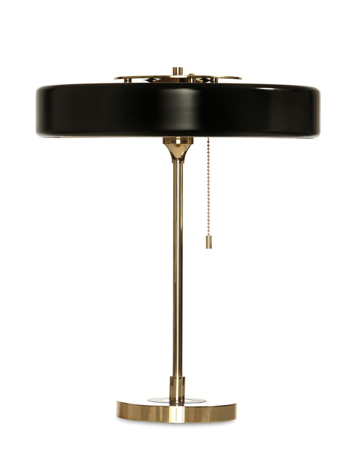 The bert frank revolve table lamp is a striking light offering a warm glow to any surface through its opal diffuser