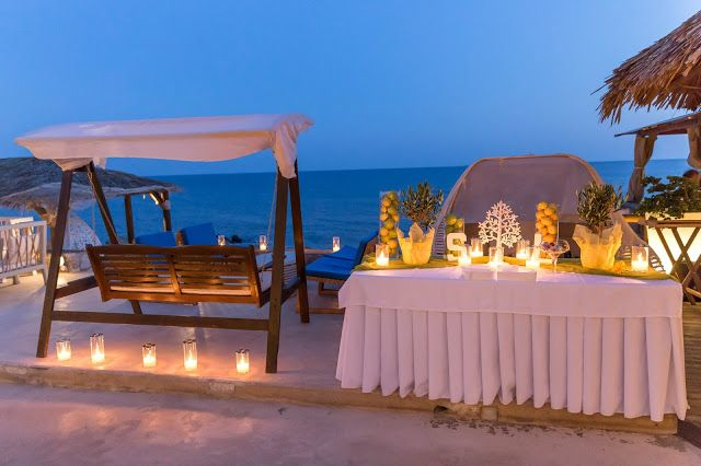 A la carte Santorini weddings.Wish table with olive trees yellow lemons,green apples & candles