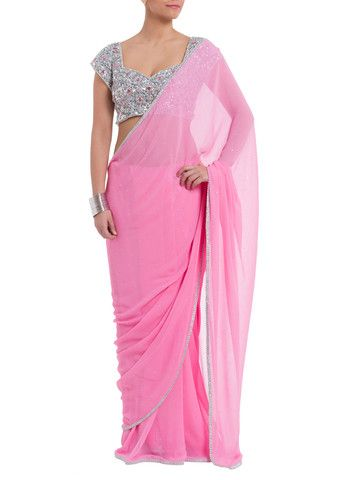 Seema Khan Pretty pink saree featuring a sparkly hand-work border. Includes a contrasting heavy silver and pink jewelled statement blouse. #Pinksaree #Saree #Designer #Womensfashion #Blouse