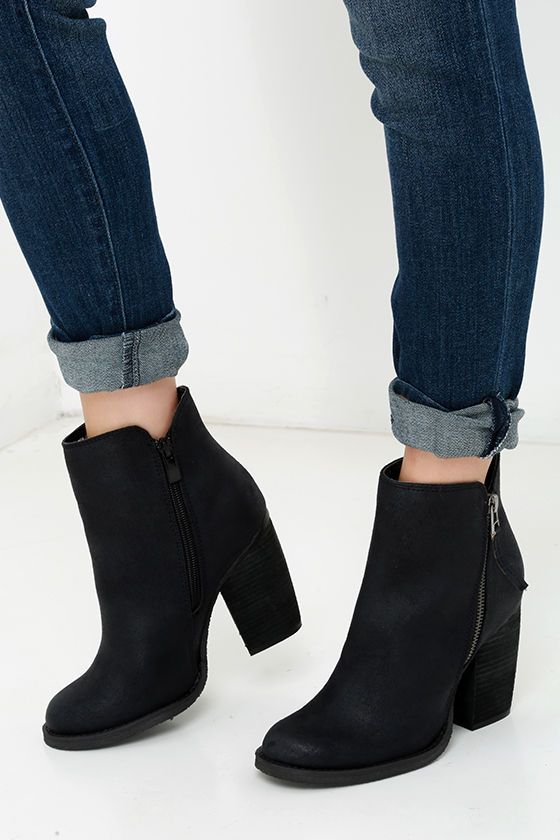 """Despite its name, you can't beat the Sbicca Percussion Black High Heel Booties! These adorable ankle boots are true winners with a tumbled faux leather upper, almond toe, and gunmetal zipper decorating the outstep. A notched 5.5"""" shaft includes a working zipper at the instep."""