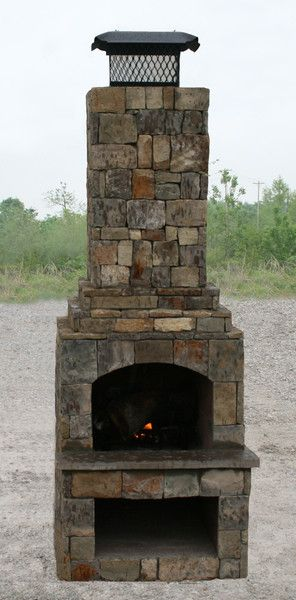 "24"" Veranda series Outdoor Fireplace Kit with natural stone veneer."